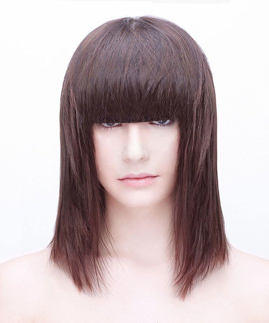 Triangle Layered Haircut Below Shoulders With a Fringe