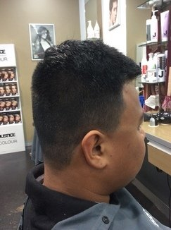 Graduated Scissor And Clipper Over Comb On A Parting Video