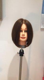 How To Cut A Triangular Graduated Bob Haircut